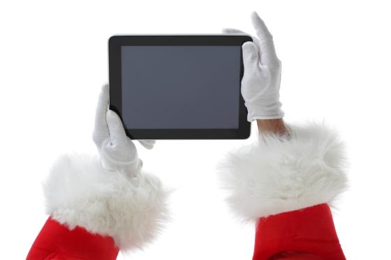 Santa holding a digital tablet